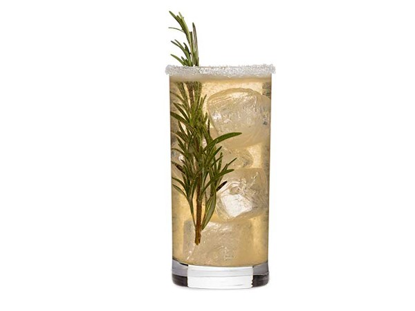 Sugar-rimmed glass of clear liquid, garnished with rosemary sprigs