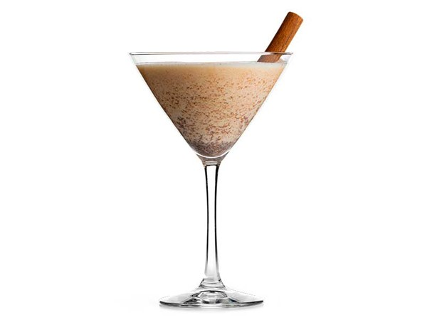 Martini glass filled with pumpkin spice, garnished with a cinnamon stick