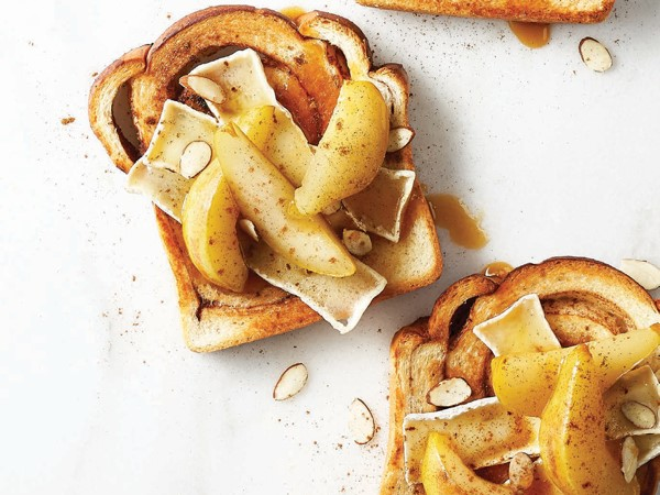 Cinnamon raisin bread topped with brie, poached pears, and sliced almonds