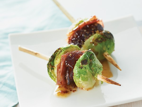Grilled and glazed brussels sprouts on wooden skewers