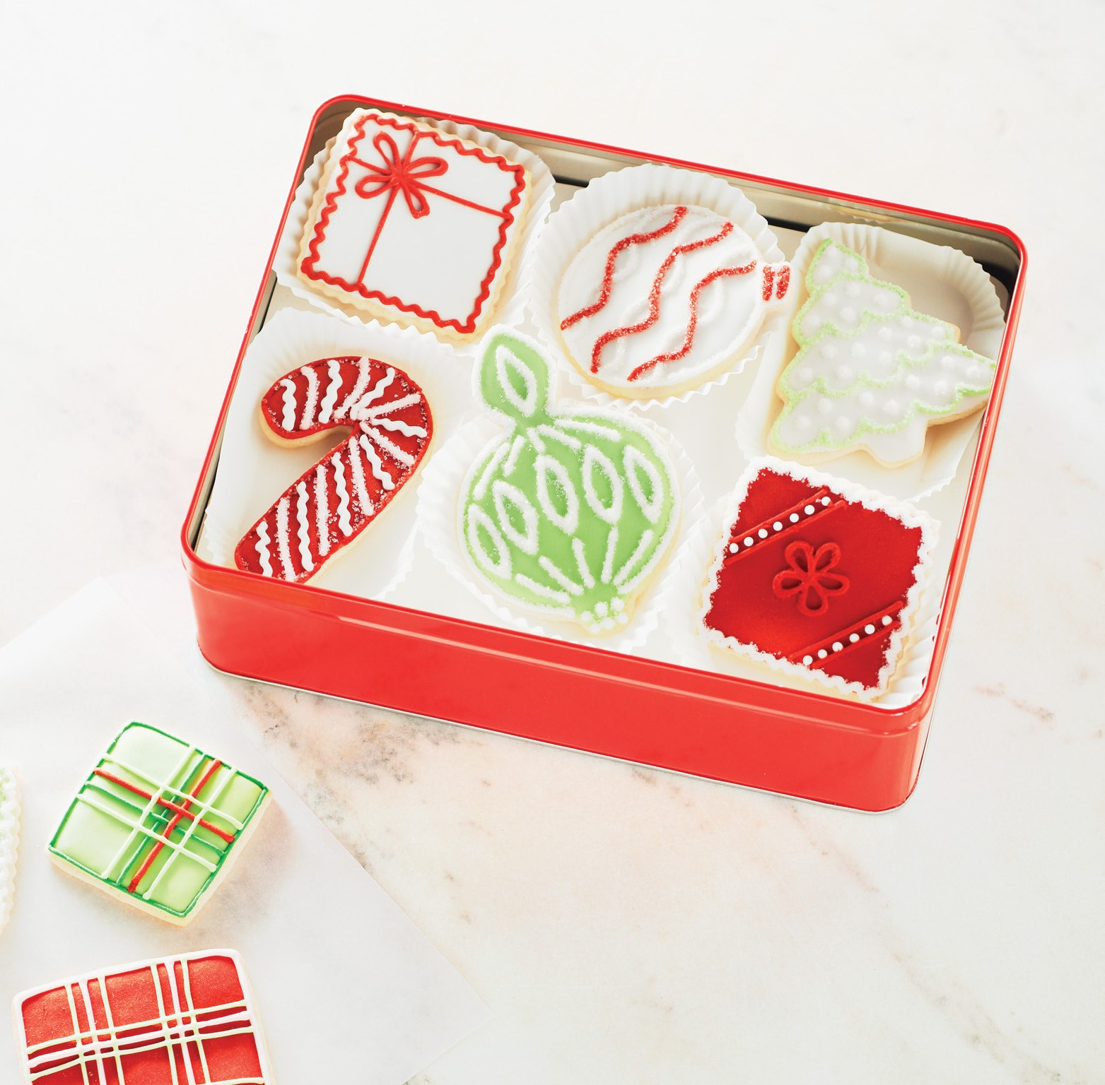 holiday gift box with decorated cookies inside