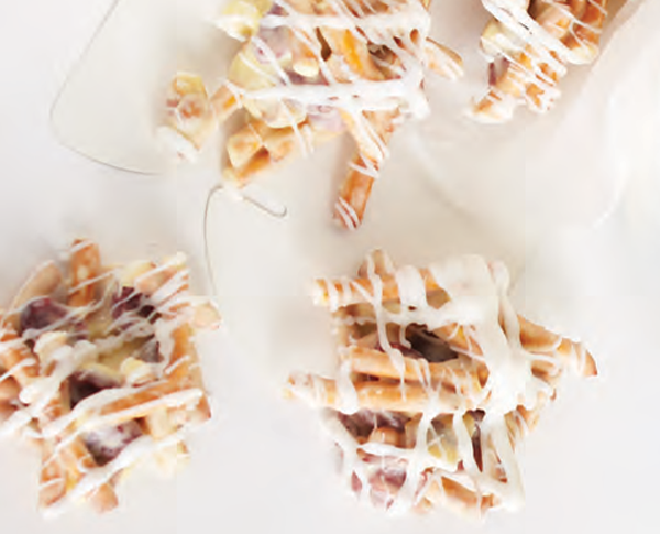 Cranberry pretzel candy clusters drizzled in white chocolate
