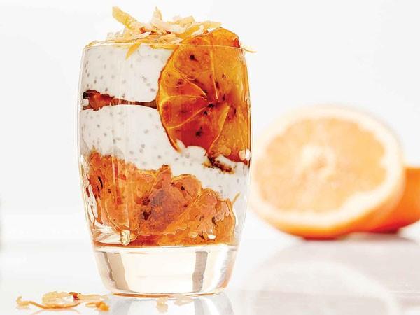Glass filled with carmelized grapefruit parfait
