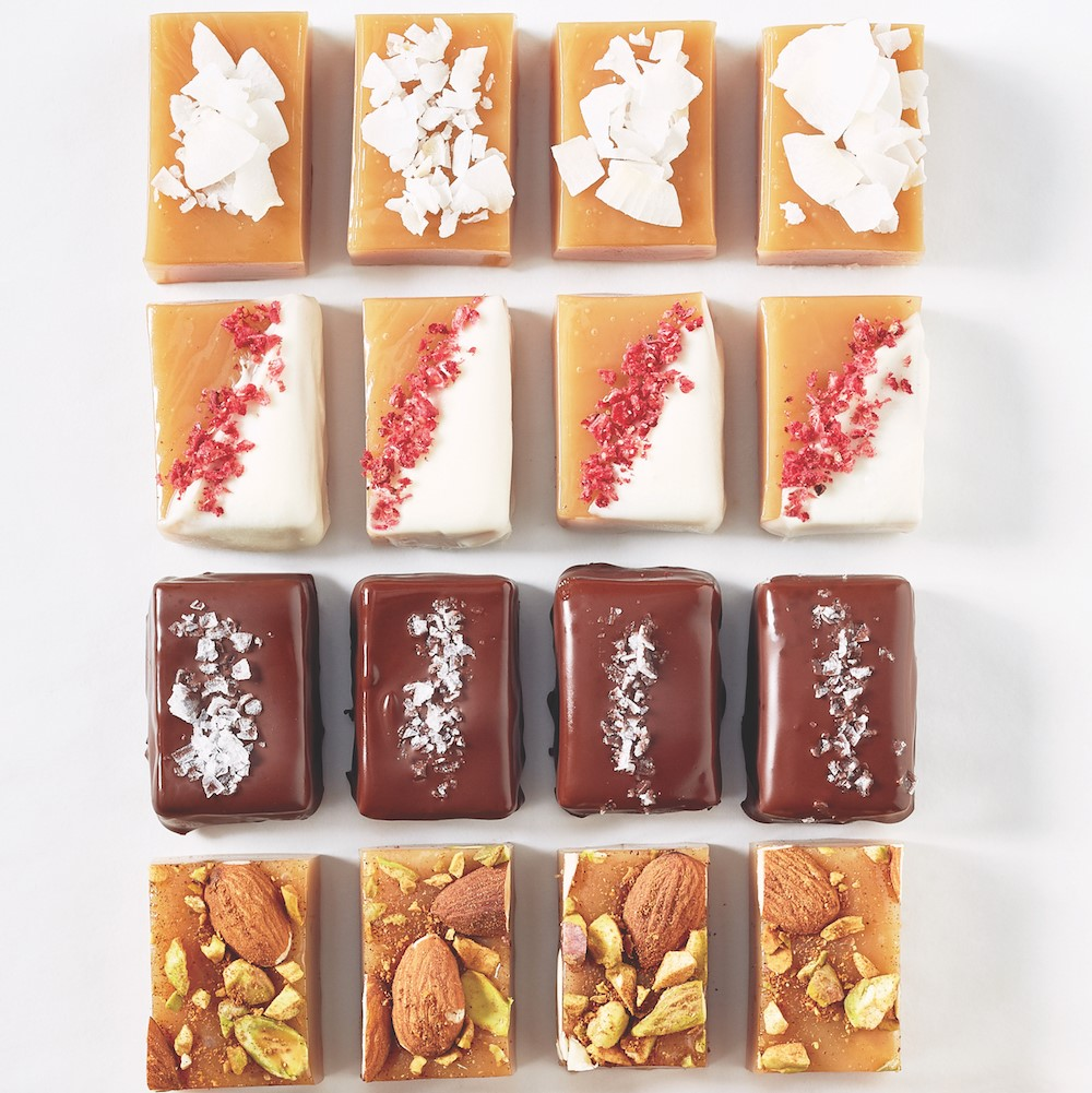 Cut caramels decorated with nuts, chocolate, and fruit