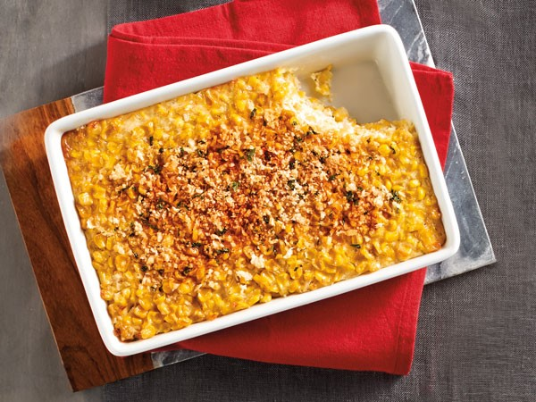 Dish of corn casserole with a slice cut out