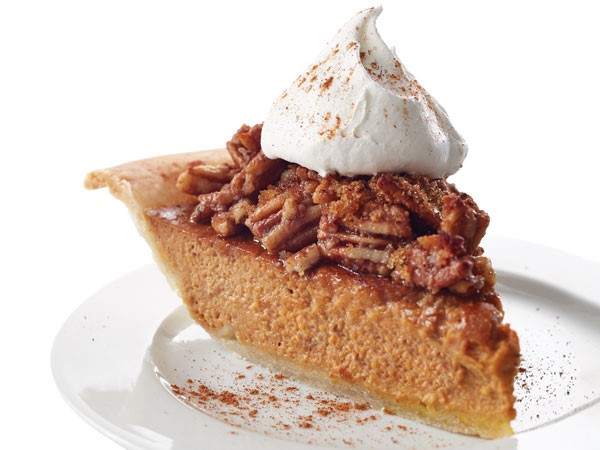 Slice of pecan pie with whipped topping
