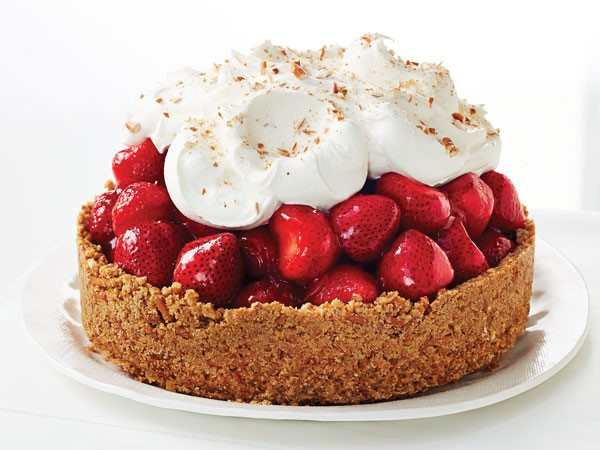 Pretzel crust topped with strawberry filling, whipped topping and garnished with crushed pretzels