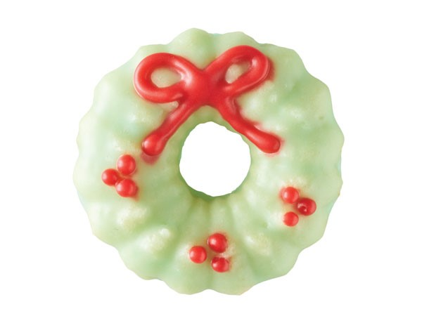 Spritz cookie decorated as holiday wreath