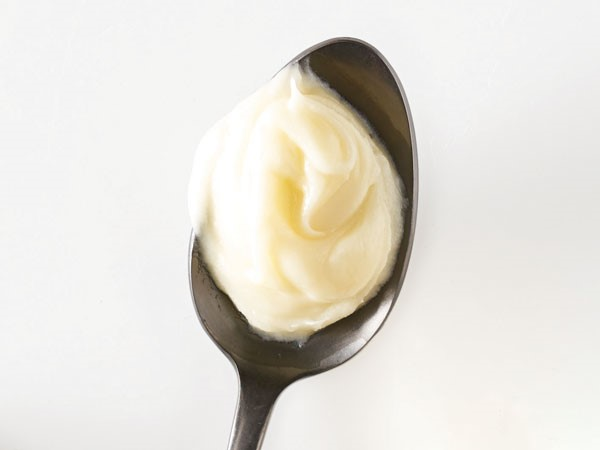 Spoonful of cream cheese frosting