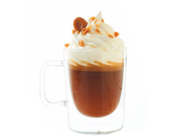 Hot buttered brandy beverage with whipped cream and toffee