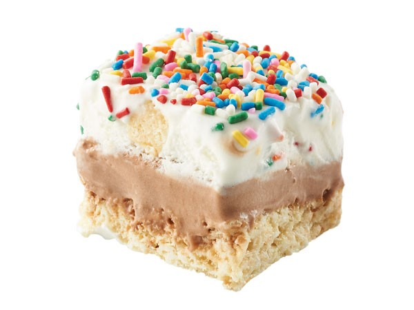 Rice krispy bar topped with chocolate icing, cake & ice cream and colored sprinkles