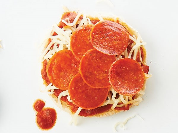 English muffin topped with pizza sauce, cheese, and pepperoni