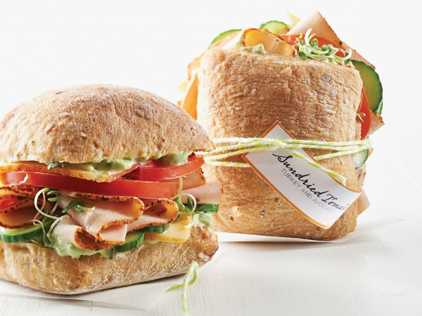 Ciabatta rolls filled with sundried tomato, turkey, avocado, tomatoes and cucumbers