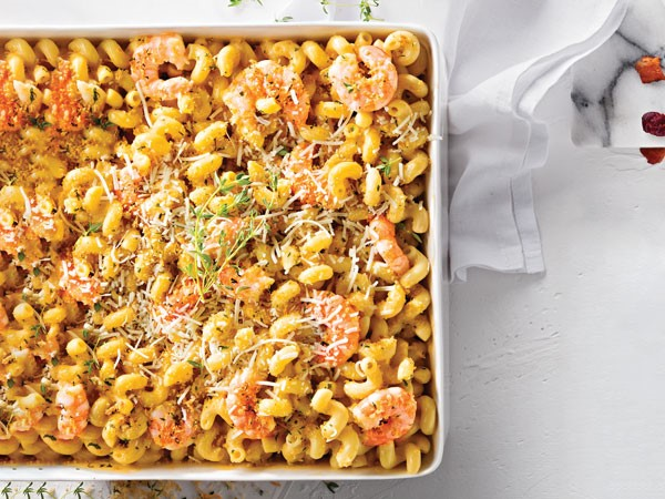 Macaroni and cheese dish topped with shrimp, panko bread crumbs, shredded parmesan and fresh thyme