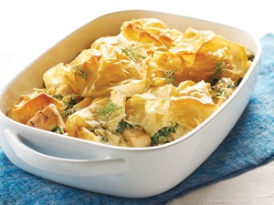 Dish filled with baked chicken spanakopita casserole