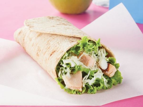 Chicken Caesar Wrap on parchment paper