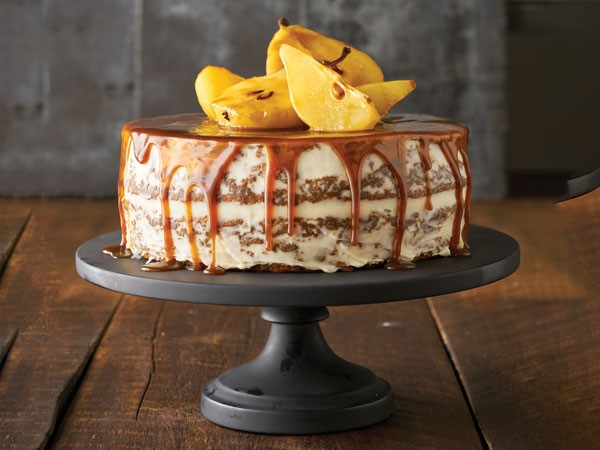 Treacle cake topped with poached pears on cake stand