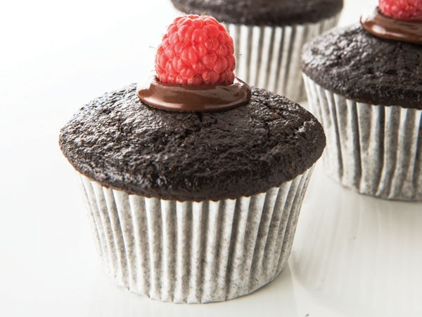 Muffin tins filled with chocolate-raspberry snack cakes
