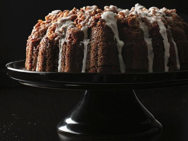 Caribbean rum white chocolate cake on a black cake stand