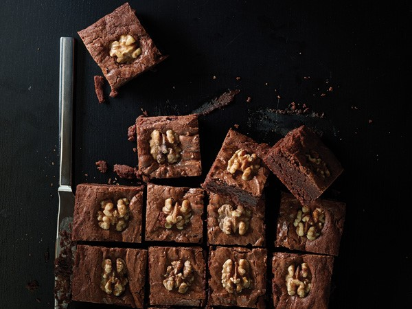 Chocolate walnut brownie squares garnished with a walnut
