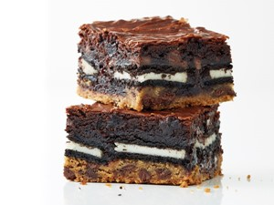 Chocolate chip cookie dough layered with cream-filled chocolate sandwich cookies and brownies
