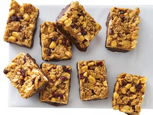 Cereal bars with dried cranberries and chocolate bottoms