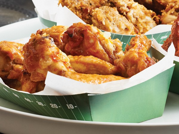 Chicken wings in green paper basket