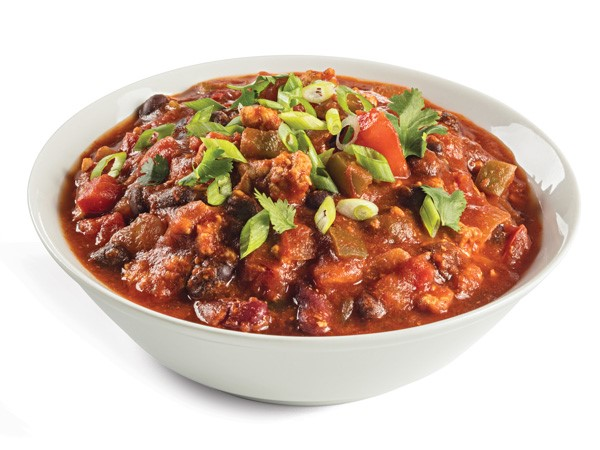 Bowl of chili garnished with cilantro and green onions