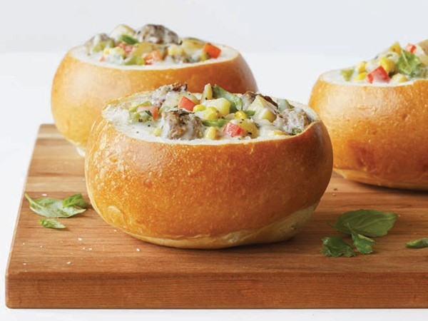Bread bowls filled with sausage-and-potato corn chowder