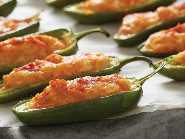 Chicken-stuffed jalapenos on parchment paper