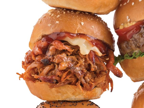 Pulled pork with BBQ sauce and cheese sandwiched between a slider bun