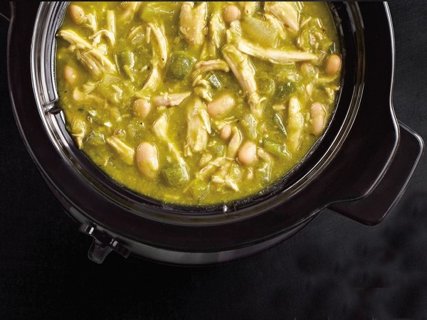 Slow cooker filled with green chicken chili