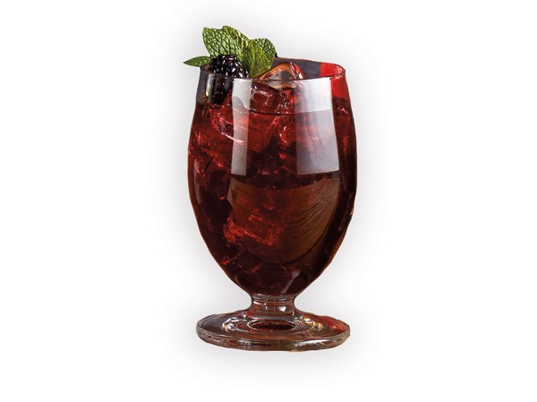 Pom Pom Daiquiri in red glass garnished with blackberry and fresh mint