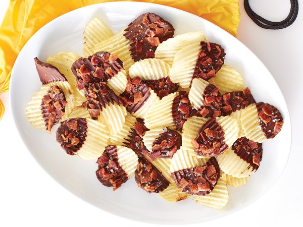 Chocolate-covered potato chips topped with bacon bits