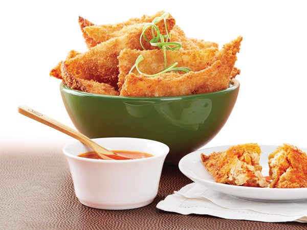 Bowl and plate of crispy-fried buffalo wing blasts served with side of buffalo sauce
