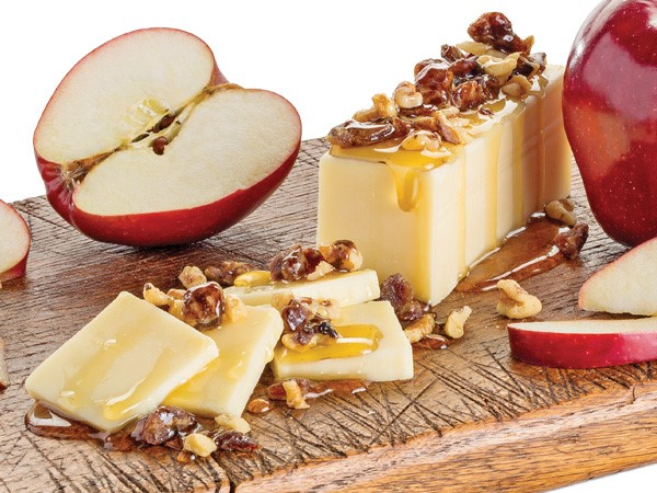 Honey glazed cheese and nuts with apples