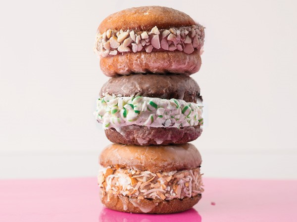 Glazed donut sandwiches filled with ice cream and dipped in candy