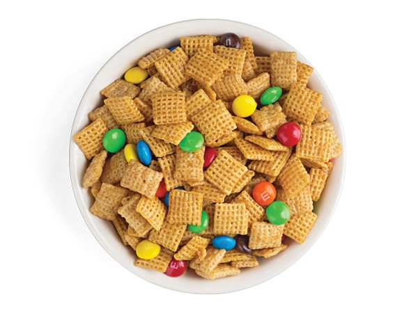 Bowl of caramel crispy chex mix combined with M&M candies