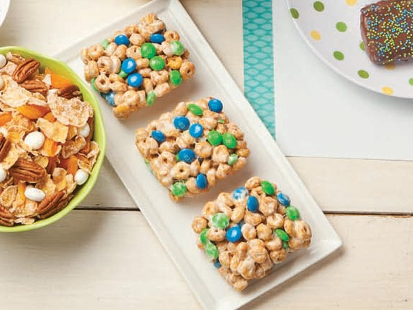 Cheerio cereal bars with blue and green chocolate covered candies