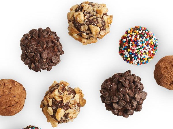 Chocolate truffles coated in cocoa powder, walnuts, mini chocolate chips or sprinkles