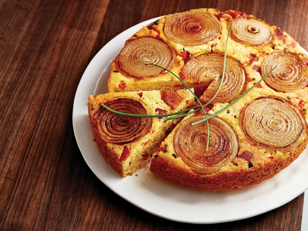 Round platter of carmelized onion corn bread topped with chives