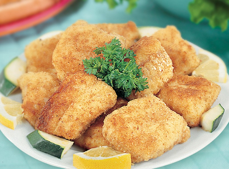 Pile of catfish nuggets on a white plate