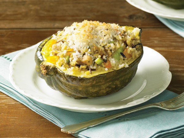 Plate of acorn squash filled with chicken and wild rice