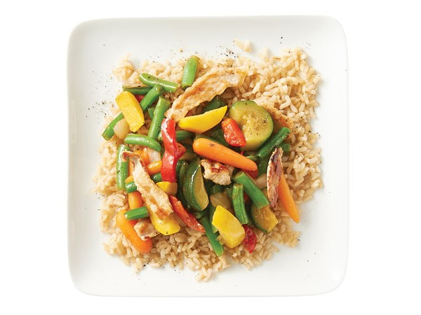 Rice topped with stir fried veggies and pork
