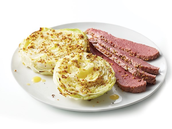 Plate of seasoned corned beef with baked cabbage steaks
