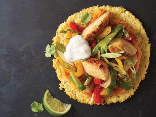 Cauliflower chicken toastada filled with peppers, onions, cilantro and sour cream