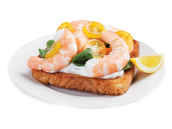 Ciabatta sandwich topped with Greek yogurt, spinach, yellow cherry tomatoes and shrimp