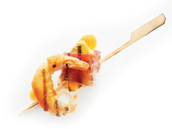 Bacon-wrapped shrimp and pineapple on a wooden skewer