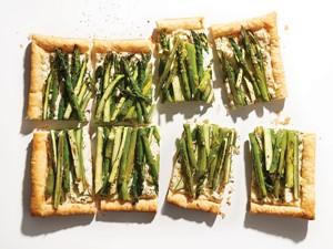 Rectangles of three-cheese tart topped with asparagus