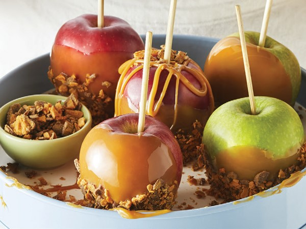 Caramel apples dipped in crushed Butterfingers